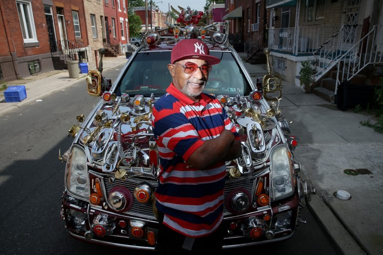 Philadelphian Gilbert Hilton has decorated his car with thousands of dollars worth of household items. (Tim Tai/ The Philadelphia Inquirer)