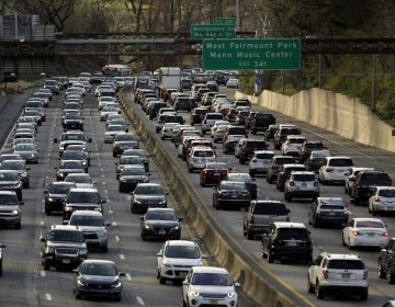 Rush-hour traffic heads west, right, and east, left, along the Schuylkill Expressway. (Jacqueline Larma/AP Photo)