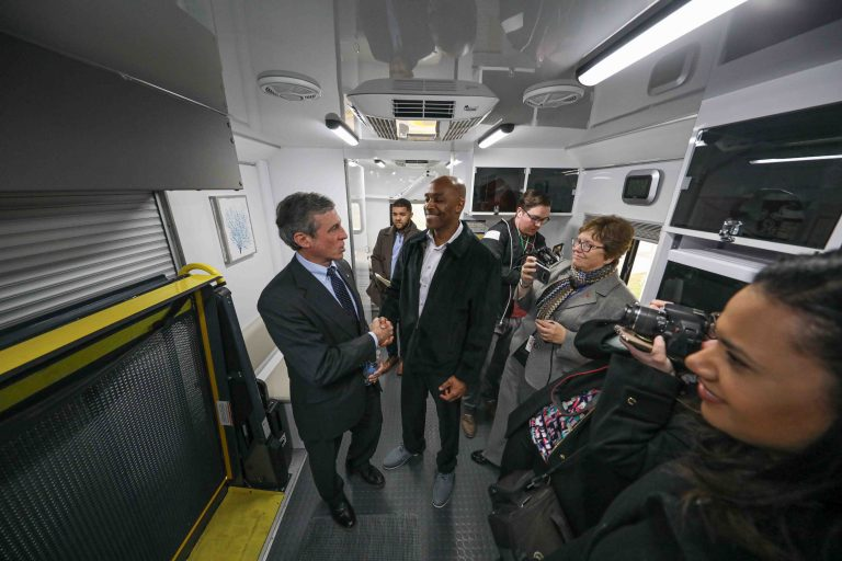 Tyrone Mathis (right) and Del. Gov. John Carney (left) shake hands after touring