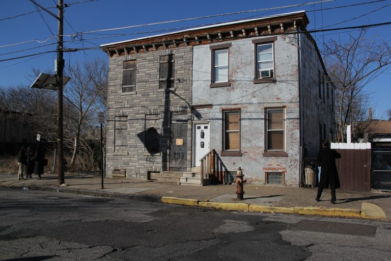 Martin Luther King Jr. stayed in the back bedroom of this house (left) on Walnut Street in Camden, according to the owner who inherited the property from her father-in-law. (Emma Lee/WHYY)