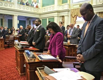 Members of Philadelphia City Council stand for a prayer at the opening of a meeting at City Hall. (Emma Lee/WHYY, file)