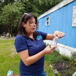 Consuelo McGovern from SERCAP collects samples for testing at a mobile home in Ellendale, Del. McGovern works for a non-profit that provides kits for testing well water. (Zoe Read/WHYY)