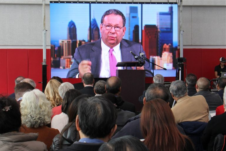 Comcast's David L. Cohen delivers a video address to the crowd at the grand opening of the Crane Chinatown community center on Nov. 8, 2019. Comcast was a major donor to the project. (Emma Lee/WHYY)