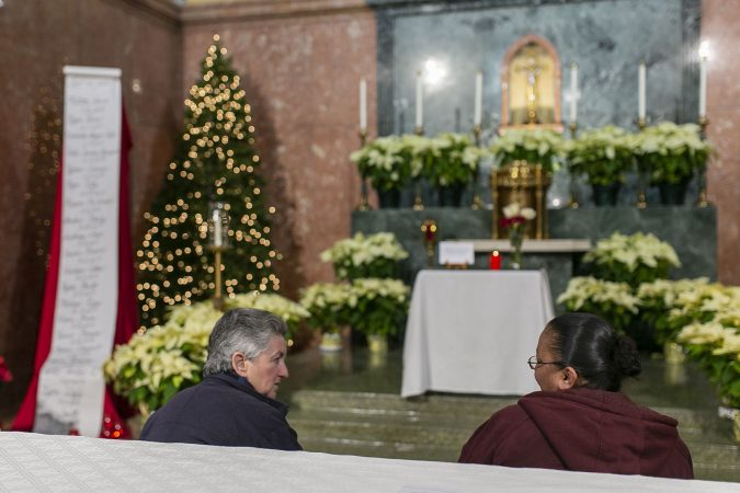 Sister Helen Cole, left, speak with Sincere Howard mother, Lissette Molina during a vigil at Parish of the Cathedral in Camden, NJ as mother and sister of Sincere pray on Monday, December 30, 2019. The 22 hours Vigil was held to commemorate the 24 murders in Camden City in the year 2019. (Miguel Martinez for WHYY).