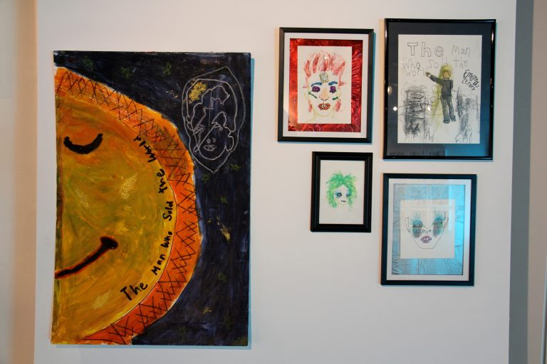 Bowie inspired art by school children is and will hang above a creative corner where visitors can create their own Bowie artworks. (Emma Lee/WHYY)