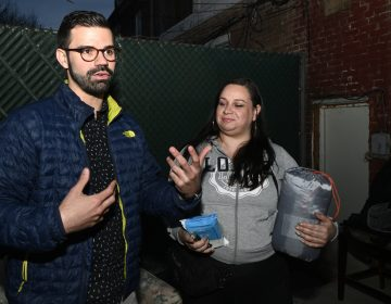 Activist and community organizer Adrian Rivera-Reyes and Vanessa Maria Graber pack emergency items to be donated as a disaster relief package, during a meeting of Philly Boricuas, on Saturday, in North Philadelphia. (Bastiaan Slabbers for WHYY)
