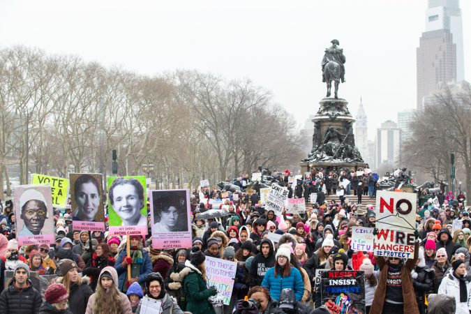 The crowd of approximately 1,000 people braved the snow and cold to attend the 4th annual Women's March on Philadelphia this Saturday, January 18th. (Becca Haydu for WHYY)