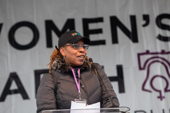 Dr. Monique Howard, Executive Director of WOAR, the only rape crisis center in Philadelphia, addressed the crowd at the Women's March this Saturday. (Becca Haydu for WHYY)