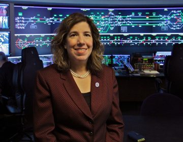 SEPTA's General Manager Leslie Richards stands in the control room at SEPTA headquarters. (Emma Lee/WHYY)