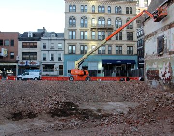 The site at 702 Sansom Street, where Toll Brothers is building a condo tower, has taken a big chunk out of Jewelers Row. (Emma Lee/WHYY)
