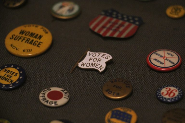 A variety of pins and buttons were used by both sides of the women's suffrage campaign. (Emma Lee/WHYY)