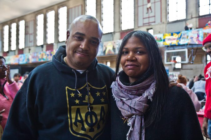 Eric Toatley with the Alpha Phi Alpha fraternity and Leslie Grace, executive director of Elements of Community, organized the Youth Financial Reality Fair for the MLK Day of Service at Philadelphia's Girard College. (Kimberly Paynter/WHYY)
