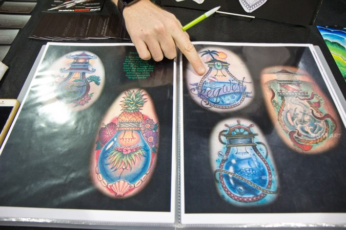 Steven Martin Jr. once saw a light bulb terrarium which inspired his popular light bulb tattoo. (Kimberly Paynter/WHYY)
