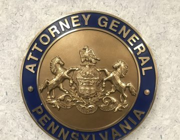 The Pa. attorney general's office seal is posted at the Safe2Say Something crisis center Jan. 13, 2020. (Brett Sholtis/WITF)