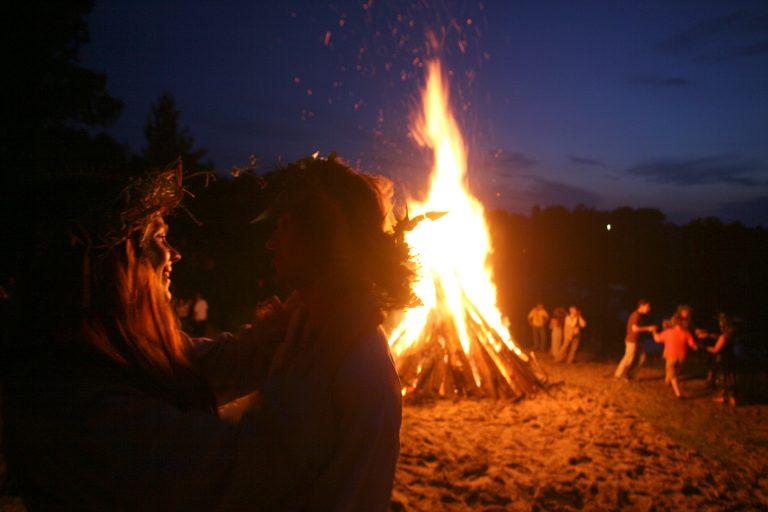 People dance around a campfire. (Vadim Rimakov/ AP Photo)