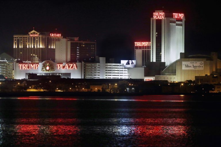 The Trump Plaza Hotel Casino is illuminated at night, just two weeks before closing on Sept. 16, 2014, in Atlantic City, N.J. (AP Photo/Mel Evans,file)