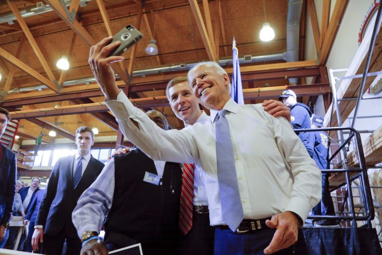 Conor Lamb, center, then a Democratic candidate for the March 13 special election in Pennsylvania's 18th Congressional District, and former Vice President Joe Biden, right, pose for a selfie with a supporter during a rally at the Carpenter's Training Center in Collier, Pa., Tuesday, March 6, 2018. (Gene J. Puskar / AP Photo)