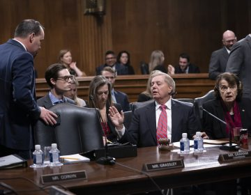 Senate Judiciary Committee Chairman Lindsey Graham, R-S.C., right, speaks with Sen. Mike Lee, R-Utah, a member of the panel, who criticized a security briefing on Iran Wednesday by Secretary of State Mike Pompeo and other top officials, saying it was