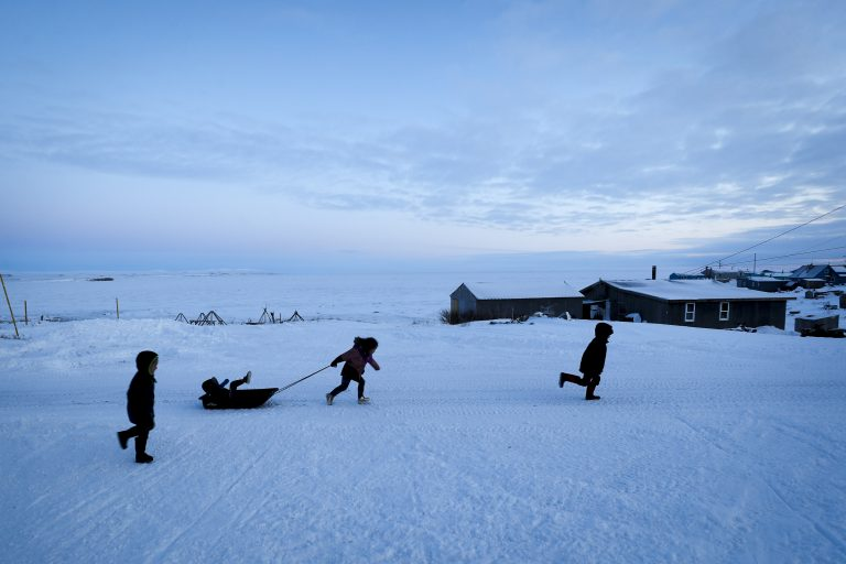Children play in the snow Saturday, Jan. 18, 2020, in Toksook Bay, Alaska. The first Americans to be counted in the 2020 Census starting Tuesday, Jan. 21, live in this Bering Sea coastal village. (Gregory Bull/AP Photo)