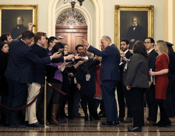 Sen. Chuck Schumer, D-N.Y., center right, talks to reporters outside the Senate chamber during a recess in the impeachment trial of President Donald Trump on charges of abuse of power and obstruction of Congress, at the Capitol in Washington, Tuesday, Jan. 21, 2020. (AP Photo/Julio Cortez)