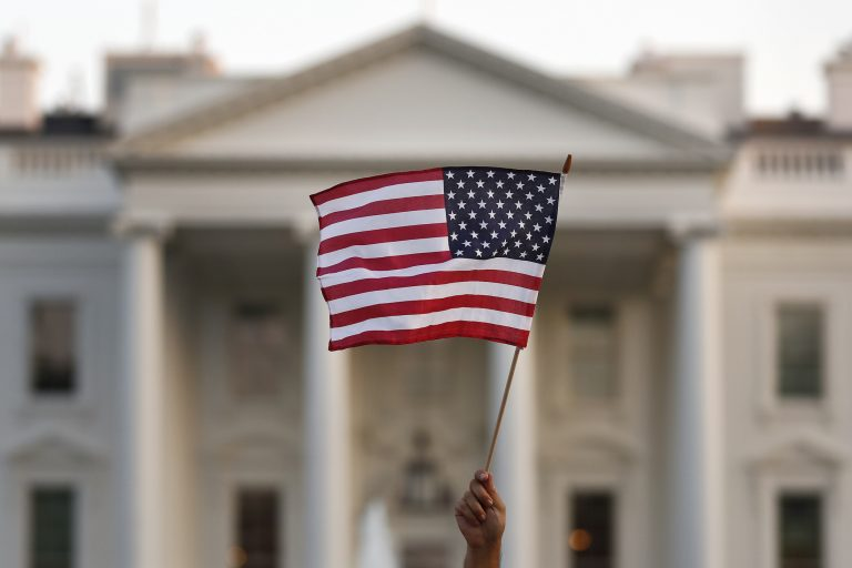 A supporter of the Deferred Action for Childhood Arrivals, or DACA, waves a flag during a rally outside the White House, in Washington, Monday, Sept. 4, 2017.  (AP Photo/Carolyn Kaster)