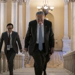Senate Minority Leader Chuck Schumer, D-N.Y., takes the stairs to speak to reporters about progress in the impeachment trial of President Donald Trump on charges of abuse of power and obstruction of Congress, at the Capitol in Washington, Thursday, Jan. 23, 2020. (AP Photo/J. Scott Applewhite)