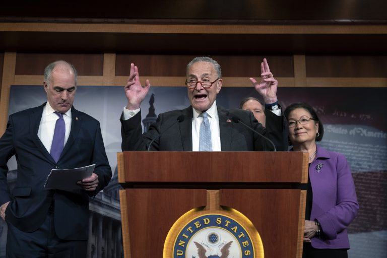 Senate Minority Leader Chuck Schumer, D-N.Y., joined from left by Sen. Bob Casey, D-Pa., Sen. Tom Udall, D-N.M., and Sen. Mazie Hirono, D-Hawaii, speaks to reporters about progress in the impeachment trial of President Donald Trump on charges of abuse of power and obstruction of Congress, at the Capitol in Washington, Thursday, Jan. 23, 2020. (AP Photo/J. Scott Applewhite)