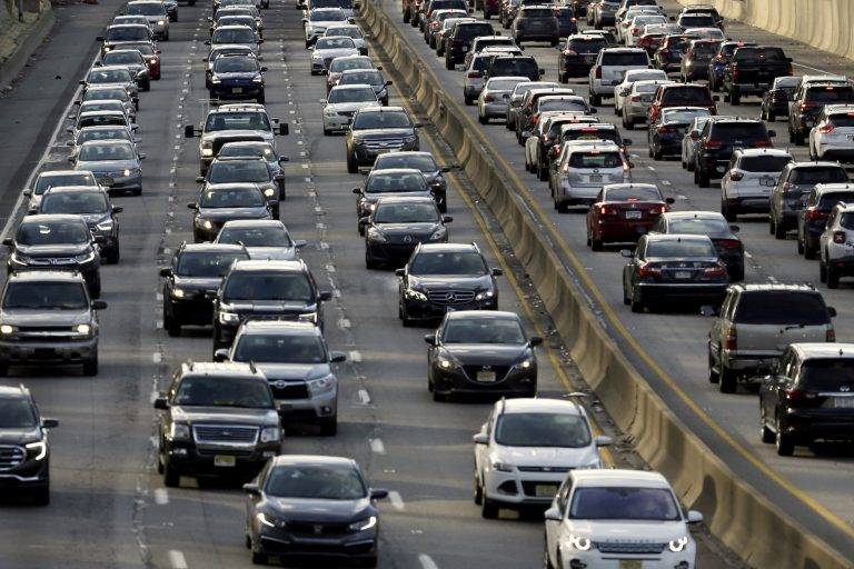 FILE - In this April 10, 2019, file photo, rush-hour traffic heads east, left, and west, right, along the Schuylkill Expressway in Philadelphia.  (Jacqueline Larma/AP Photo)