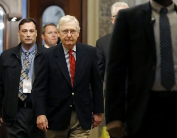 Senate Majority Leader Mitch McConnell of Ky., center, arrives at the Capitol in Washington during the impeachment trial of President Donald Trump on charges of abuse of power and obstruction of Congress, Saturday, Jan. 25, 2020. (Julio Cortez/AP Photo)