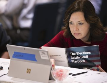 Mandy Vigil, from New Mexico, works during an exercise run by military and national security officials, for state and local election officials to simulate different scenarios for the 2020 elections, Monday, Dec. 16, 2019, in Springfield, Va. (Alex Brandon/AP Photo)