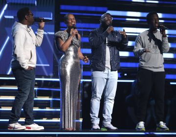 Nathan Morris, from left, Wanya Morris, Shawn Stockman, of Boyz II Men‎, and Alicia Keys, second left, sing a tribute in honor of the late Kobe Bryant at the 62nd annual Grammy Awards on Sunday, Jan. 26, 2020, in Los Angeles. (Matt Sayles/Invision/AP Photo)