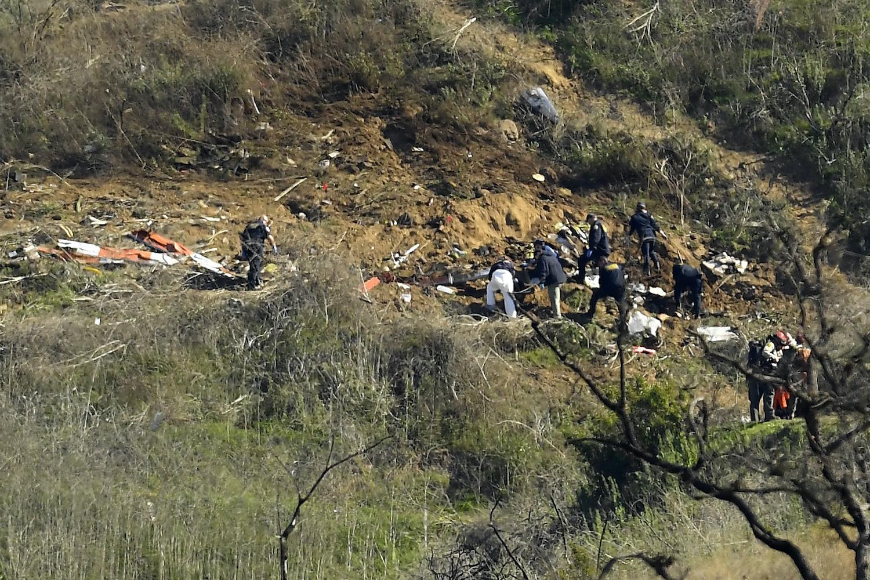 Investigators work the scene of a helicopter crash