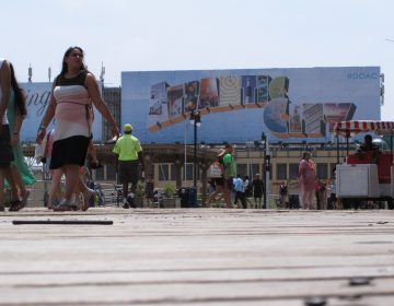 This July 3, 2015 photo shows people walking on the Boardwalk in Atlantic City N.J. On Jan. 30, 2020, top executives from eight of the city's nine casinos said Atlantic City needs to be cleaned up and made safer before business conditions will improve. (Wayne Parry/AP Photo)