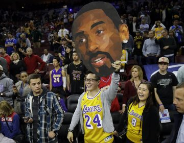 Fans of Los Angeles Lakers' Kobe Bryant watch him practice ahead of a basketball game against the Philadelphia 76ers Tuesday, Dec. 1, 2015, in Philadelphia. (AP Photo/Matt Rourke)