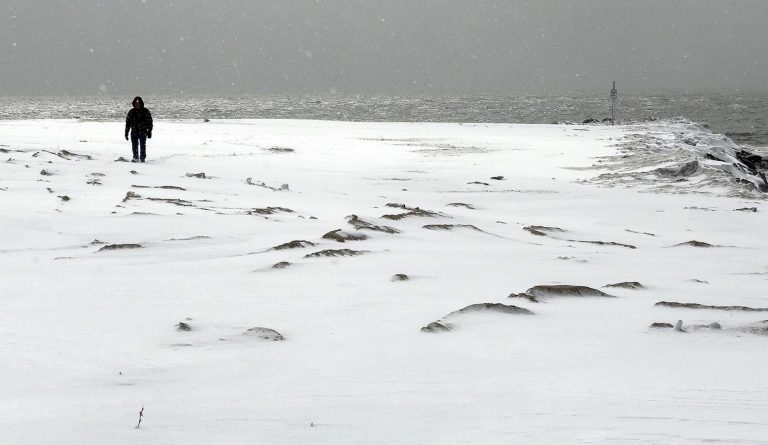 Ken Phillips walks on a snow-covered beach at 2nd Avenue in Cape May, N.J., Thursday, Feb. 26,  2015. (AP Photo/The Press of Atlantic City, Dale Gerhard)