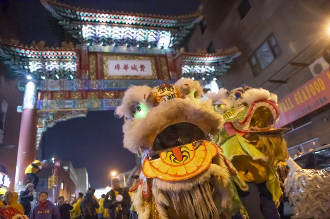 Lion dancers from the Philadelphia Suns perform in front of the Chinese Friendship Gate in Chinatown celebrating the Lunar New Year. (Jonathan Wilson for WHYY)