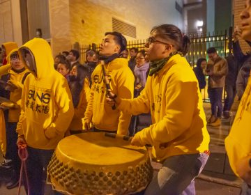 Philadelphia Suns percussionists beat out the rhythm for the lion dancers. (Jonathan Wilson for WHYY)