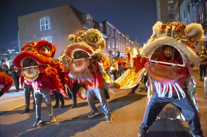 Cheung's Hung Gar Kung Fu Academy ‭lion dancers parade along North 10th Street in Chinatown.(Jonathan Wilson for WHYY)
