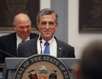 Delaware Governor John Carney grins during his 2020 State of the State address at Legislative Hall in Dover, Delaware on Thursday, Jan. 23, 2020.  (Butch Comegys / For WHYY)