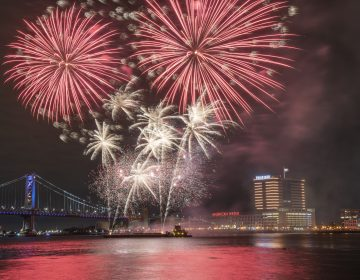 Fireworks are launched from a barge in the Delaware River as seen from Penns Landing.(Jonathan Wilson for WHYY)