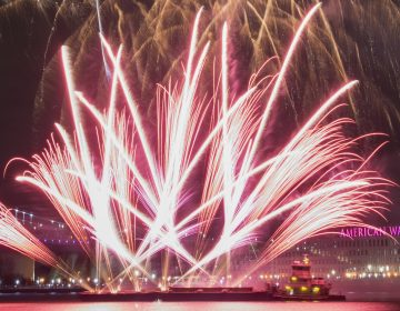 Fireworks are launched from a barge during the midnight display at Penn's Landing. (Jonathan Wilson for WHYY)