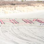 Donovan Rankin II felt inspired after his run on the beach Sunday and created a Trump sign made of sand. (XImena Conde/WHYY)