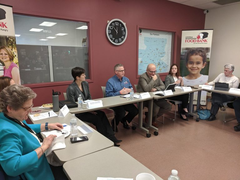 Executive Director of the Central Pennsylvania Food Bank Joe Arthur (center) speaks during a roundtable discussion on proposed cuts to the Supplemental Nutrition Assistance Program (SNAP) in Harrisburg on Monday, Jan. 13, 2020. (Rachel McDevitt/WITF)