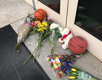 Fans pay tribute in memory of Kobe Bryant at Lower Merion High School, in Ardmore, Pa. The Los Angeles Lakers superstar died on Sunday in a helicopter crash. (Jennifer Lynn/WHYY News)