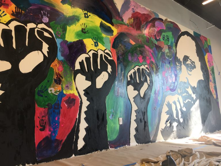 A new mural honoring Dr. Martin Luther King Jr. was finished by student volunteers at The Warehouse, a new teen center opening soon in northeast Wilmington. (Mark Eichmann/WHYY)