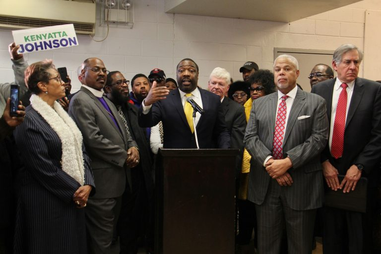 Philadelphia City Councilman Kenyatta Johnson is surrounded by supporters at a press conference where he declares his innocence after the announcement on Wednesday of federal corruption charges against him and his wife. (Emma Lee/WHYY)