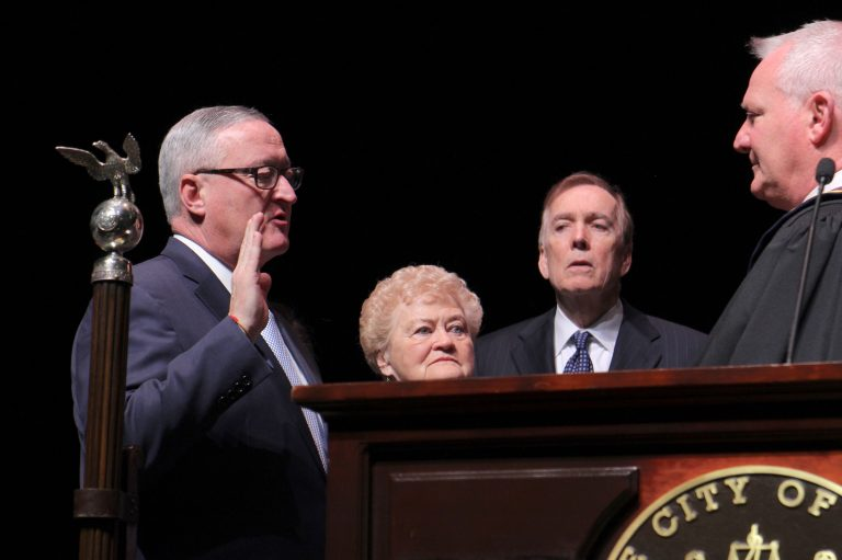 Mayor Jim Kenney is sworn in to his second term, flanked by his mother, Barbara. (Emma Lee/WHYY)