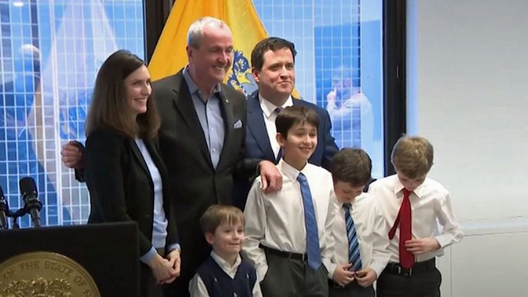 Kevin Walsh and his family with Gov. Phil Murphy on Thursday. (NJTV News)