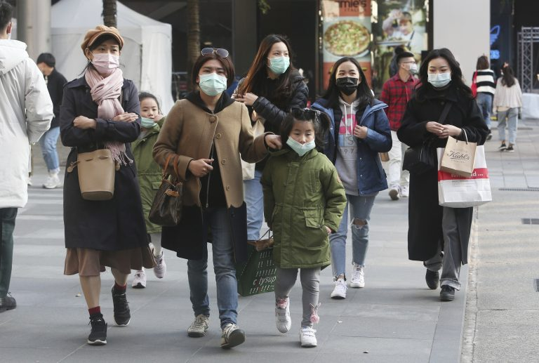 People wear face masks as they visit a shopping district in Taipei, Taiwan, Friday, Jan. 31, 2020. People wear face masks as they walk through a shopping mall in Taipei, Taiwan, Friday, Jan. 31, 2020. (AP Photo/Chiang Ying-ying)