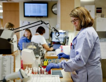 Women got the lion's share of new jobs in December and now outnumber men on U.S. payrolls. This unusual situation reflects the growth of industries like health care where women dominate. (John Minchillo/AP Photo)